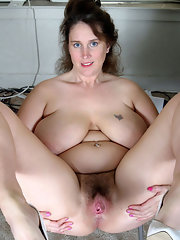 chubby blonde granny exposes her hairy pussy on sofa