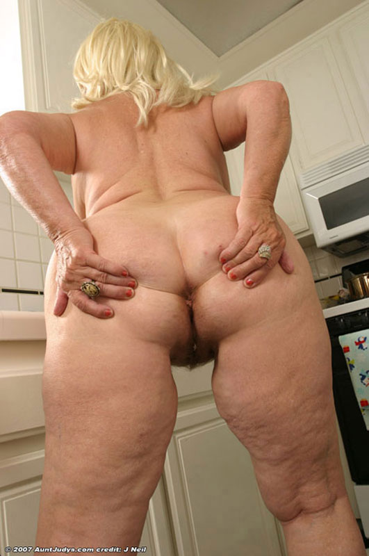 Sexy housewife takes a break from baking cookies 3