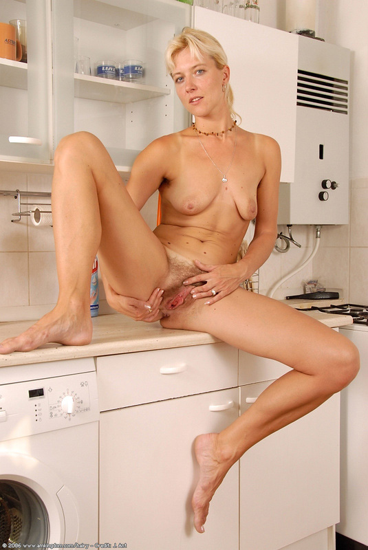 Naked Milf In Kitchen