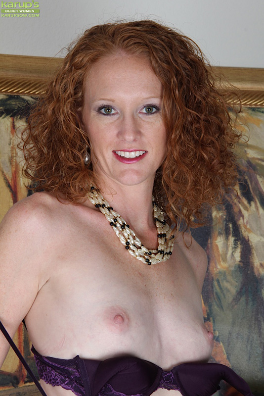 small breasted curly redhead ande exposes her older pussy