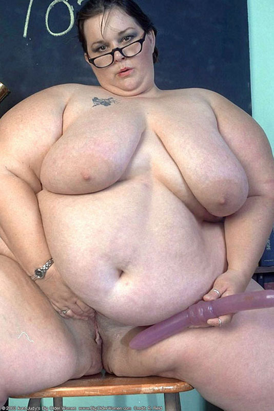 image Plump brunette with enormous tits pleasures h