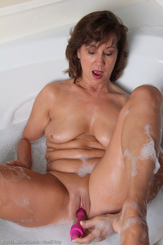 Busty old mom enjoying two cock at once